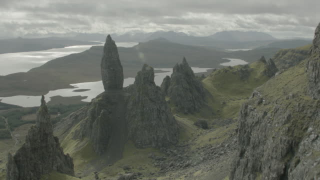 aerial over green highlands, ocean and rocky cliffs; isle of skye, scotland, uk - scotland stock videos & royalty-free footage