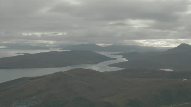 aerial over green highlands, ocean and rocky coastline; isle of skye, scotland, uk - scottish highlands stock videos & royalty-free footage