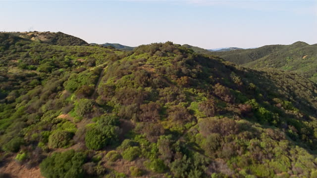 aerial over green mountains / los angeles - southern california stock videos & royalty-free footage