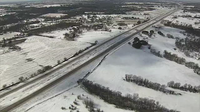 aerial over highway in the dallas suburbs with snow on the ground. - texas stock videos & royalty-free footage
