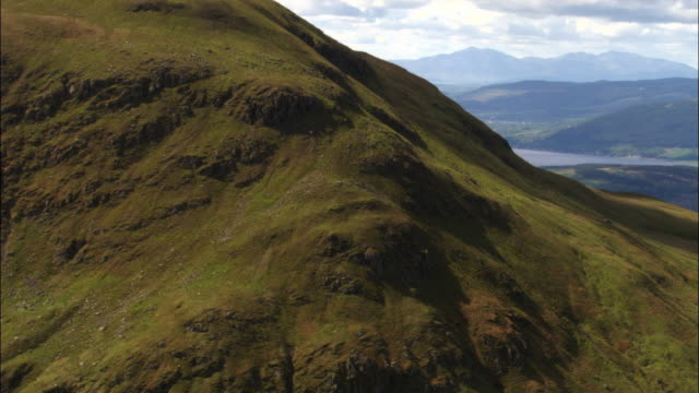 aerial over hills and mountains, scotland, uk - scottish highlands stock videos and b-roll footage
