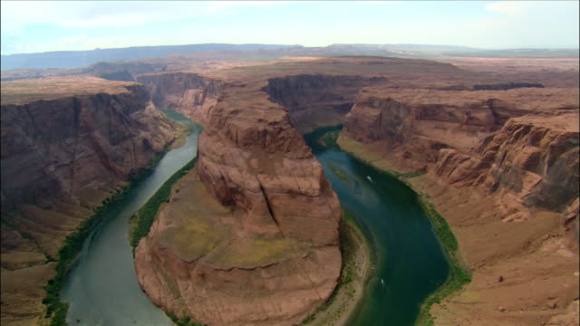 aerial over horseshoe bend / boat approaching riverbank / colorado river / page, arizona - river colorado stock videos & royalty-free footage