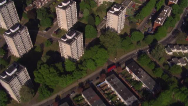 Aerial over houses and tower blocks in Roehampton, London, UK