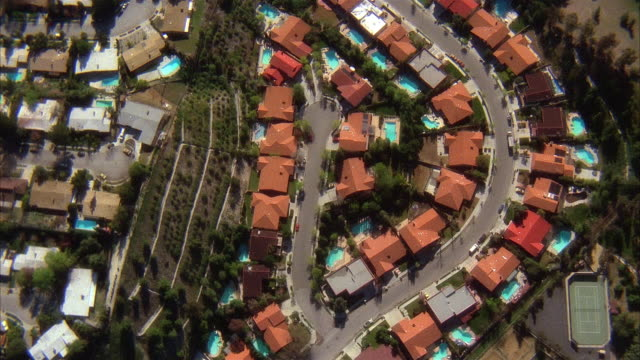 aerial over houses in suburban neighborhood / swimming pools in backyards / san fernando valley, ca - 1987 stock videos & royalty-free footage