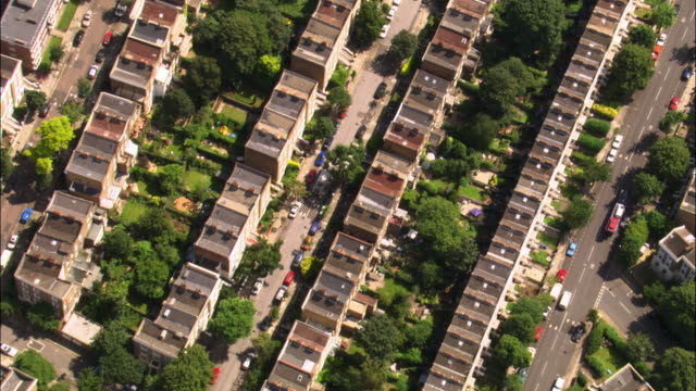 Aerial over houses, streets and gardens, London, UK