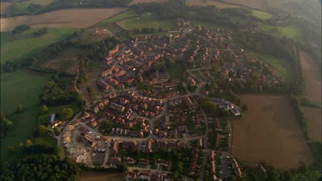 Aerial over housing estate in North Downs in evening / Surrey, England
