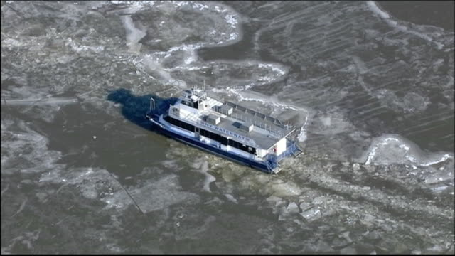 aerial over hudson river ferry trapped in ice rescued by ice cutter hudson river ferry rescue aerials ferry had to be rescued after ice flow trapped... - produced segment stock videos & royalty-free footage