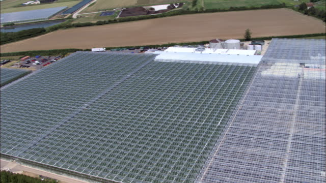 Aerial over huge greenhouses, UK