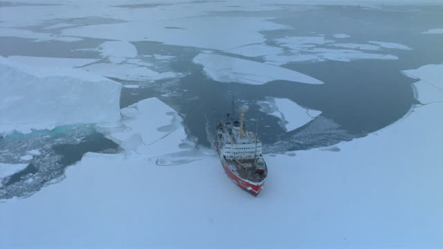 aerial over ice breaker ship moving through icy water / canada - arctic stock videos & royalty-free footage
