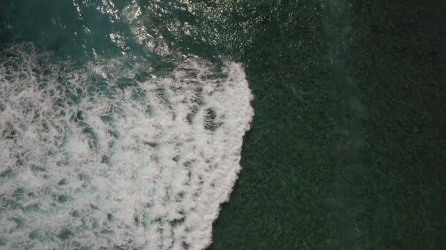 aerial over indian ocean water near reunion island coastline - indian ocean stock videos & royalty-free footage
