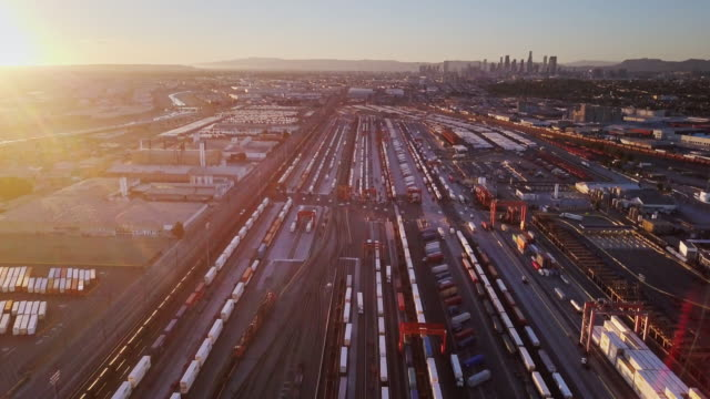 aerial over intermodal freight yard near downtown los angeles - unloading stock videos & royalty-free footage