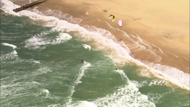 aerial over kite surfers on bournemouth beach, dorset, uk - bournemouth england stock videos & royalty-free footage