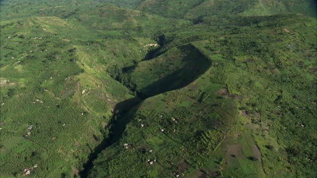 Aerial over Kyambura gorge, farms and banana plantations, Uganda