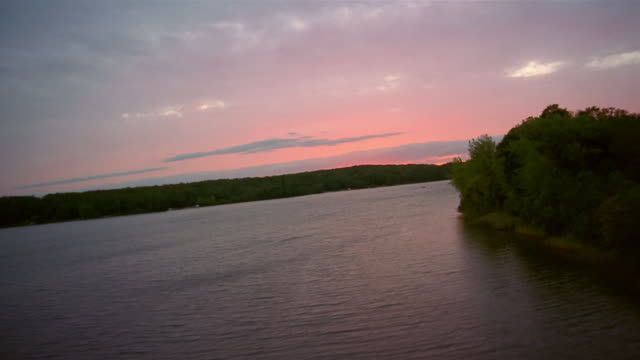 aerial over lake at sunset / minnesota - reed grass family stock videos and b-roll footage