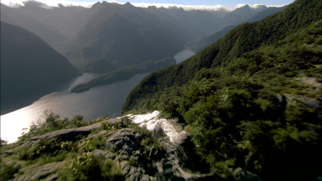 Aerial over Lake Browne to Browne Falls cascading into Doubtful Sound/ Lake Fiordland National Park, New Zealand