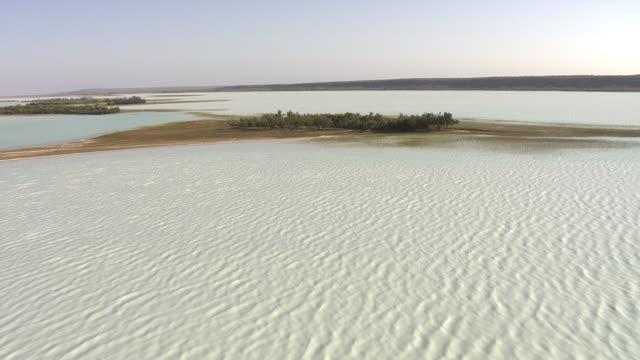 "aerial over lake tsimanampetsotsa, madagascar - ""bbc natural history"" stock videos & royalty-free footage"