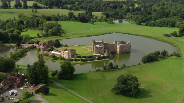 aerial over leeds castle surrounded by moat / kent, england - circa 12th century stock videos and b-roll footage