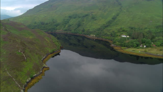 Aerial over Loch Long in Scottish Highlands with reflection of valley in still water / Scotland