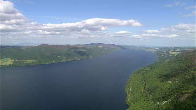Aerial over Loch Ness towards Urquhart Castle / Highland, Scotland
