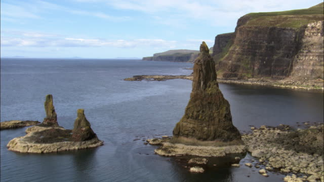 Aerial over Macleod's Maidens sea stacks, Isle of Skye, Scotland, UK