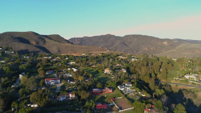 Aerial over Malibu hills area in slow motion UHD