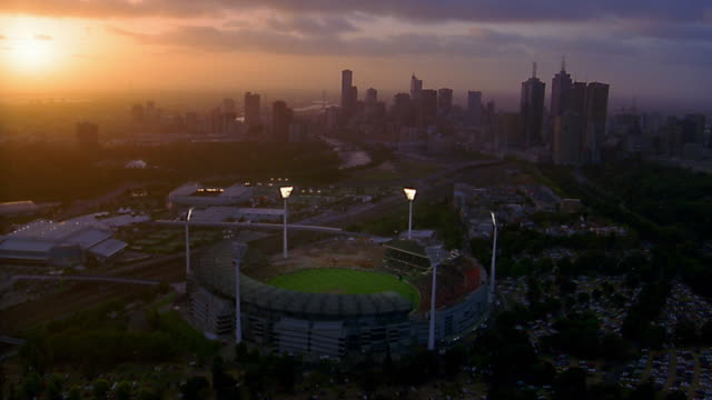 Aerial over Melbourne Cricket Ground / skyline in background