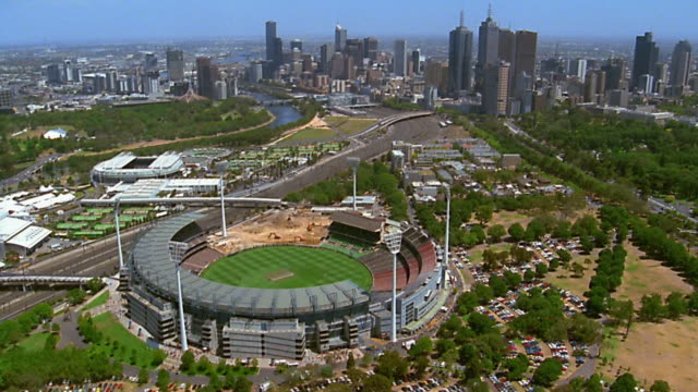 aerial over melbourne cricket ground / skyline in background - 2003年点の映像素材/bロール