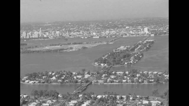 aerial over miami, florida in the 1950s. - miami stock videos & royalty-free footage