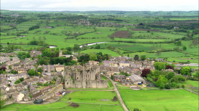 Aerial over Middleham Castle and town, Yorkshire, UK