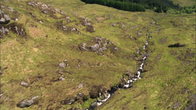 Aerial over Moidart mountain stream, Scotland, UK