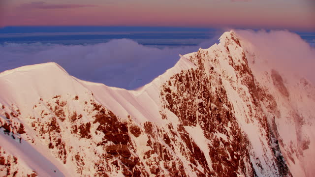 aerial over mount cook summit clouds - mountain range stock videos & royalty-free footage