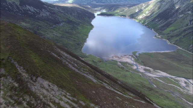 aerial over mountain and loch, scotland, uk - scottish culture video stock e b–roll