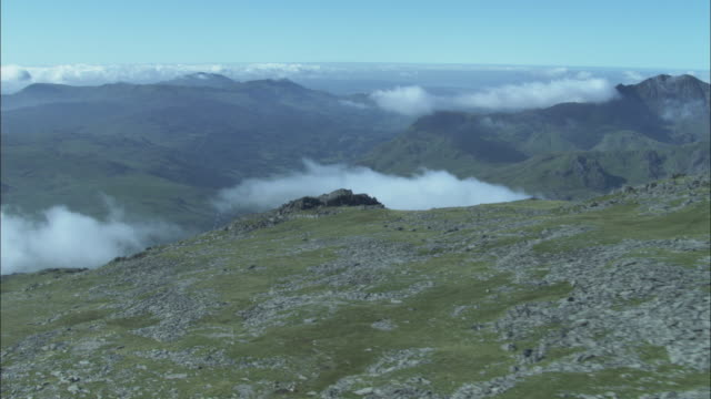 aerial over mountain in snowdonia, wales, uk - snowdonia stock videos & royalty-free footage
