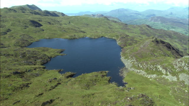 aerial over mountain lake in snowdonia, wales, uk - snowdonia stock videos & royalty-free footage