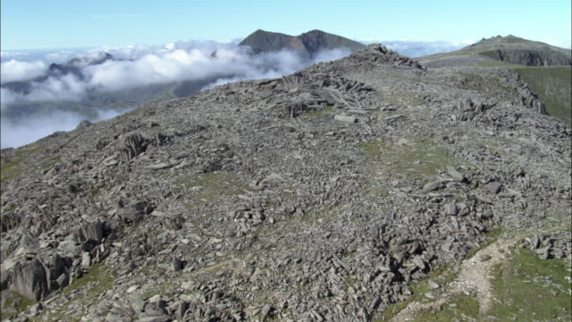 aerial over mountain peak in snowdonia, wales, uk - snowdonia stock videos & royalty-free footage
