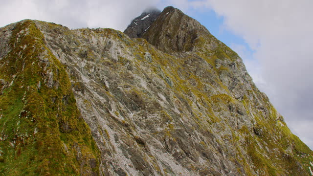 aerial over mountain summit milford sound - helicopter point of view stock videos & royalty-free footage