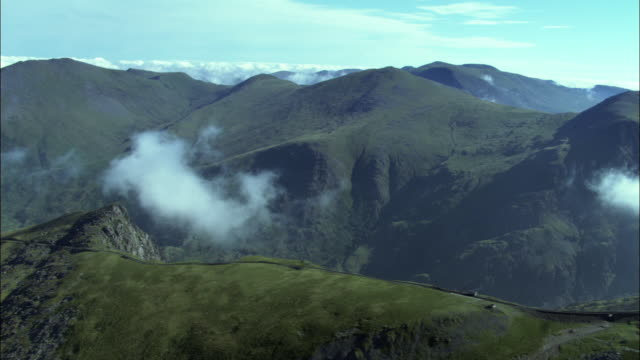 aerial over mountains in snowdonia, wales, uk - snowdonia stock videos & royalty-free footage