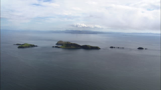 aerial over oceans and shiant islands in outer hebrides, scotland, uk - hebrides stock videos and b-roll footage