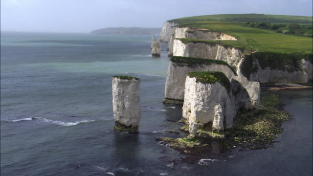 aerial over old harry rocks and sea, dorset, uk - rock formation stock videos & royalty-free footage