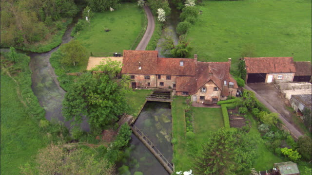 aerial over old watermill on river itchen, hampshire , uk - hampshire england stock videos and b-roll footage