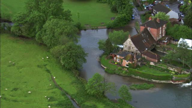aerial over old watermill, salisbury, uk - watermill stock videos & royalty-free footage