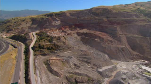 Aerial over open pit mine along Interstate 15 near Salt Lake City, Utah