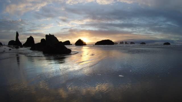 pov aerial over over beach at bandon beach at sunset, oregon - water's edge stock videos & royalty-free footage