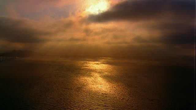 Aerial over Pacific Ocean at sunset