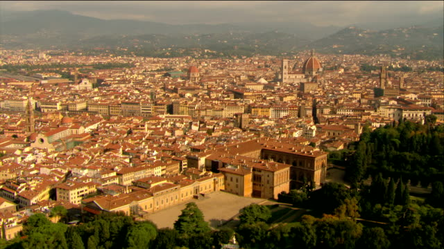 aerial over palazzo pitti with view of santa maria del fiore / florence, italy - fiore stock videos & royalty-free footage