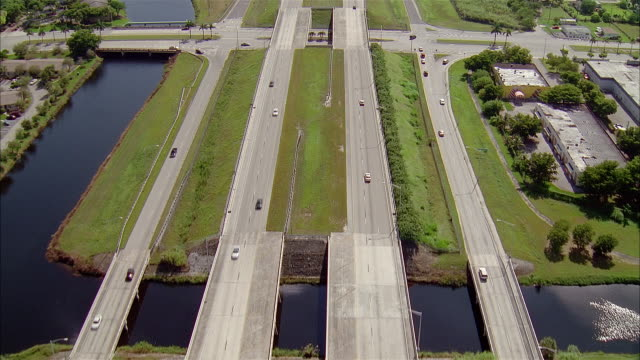aerial over parallel highways along water / zoom in to cars / miami, florida - 2002 stock videos & royalty-free footage