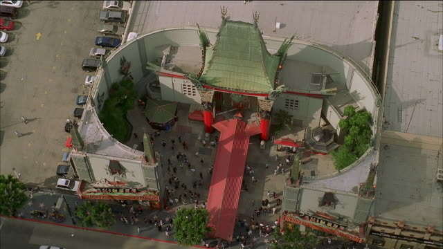 aerial over pedestrians and traffic outside grauman's chinese theatre / los angeles, california - tcl chinese theatre stock videos & royalty-free footage