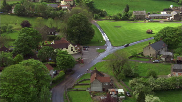 Aerial over Priddy village, Somerset, UK