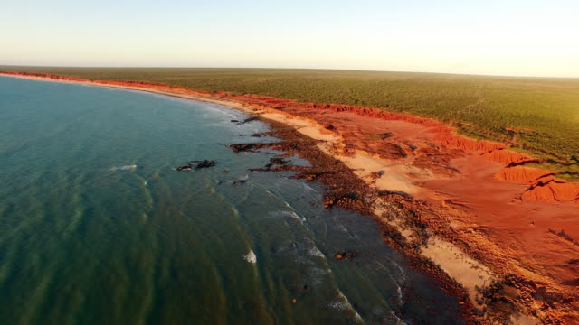 aerial over red cliff and kimberley coastline - coastline stock videos & royalty-free footage