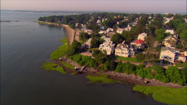 aerial over residential houses along coast / squantum, quincy, massachusetts - massachusetts stock videos & royalty-free footage